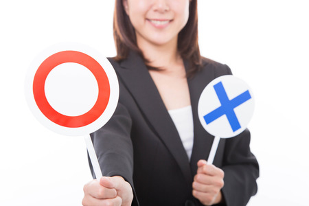 Young businesswoman showing with Yes sign on a white background