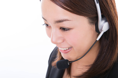 Young customer support operator with headset and smiling