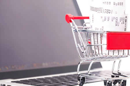 Shopping cart with receipt on laptop