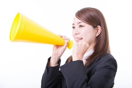 Business woman clenched fist and holding megaphone Stock Photo
