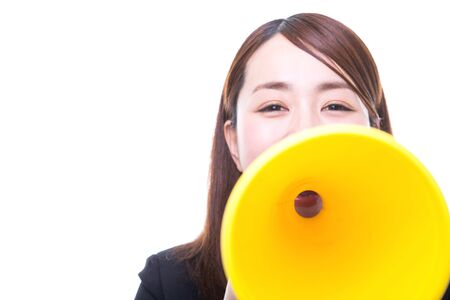 Smiling young woman making announcement with megaphone