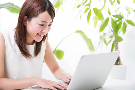 Young woman with laptop 写真素材