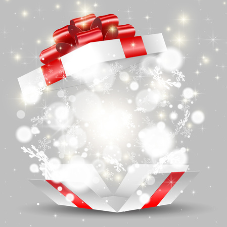 Opened white gift box with snowflakes and lights