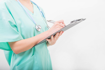 Hands of young medical doctor woman writing on a clipboard