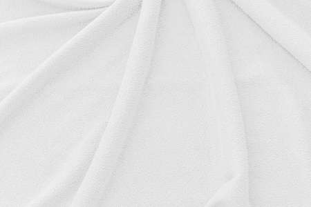 White fabric texture background. Abstract wave canvas surface. Stock Photo