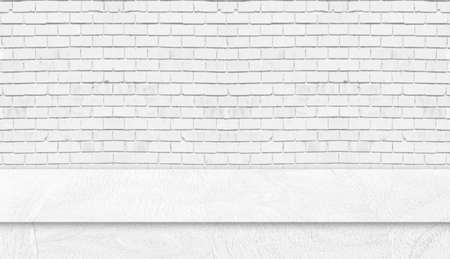 White wood table studio with white brick wall. Background for advertise product or web banner.