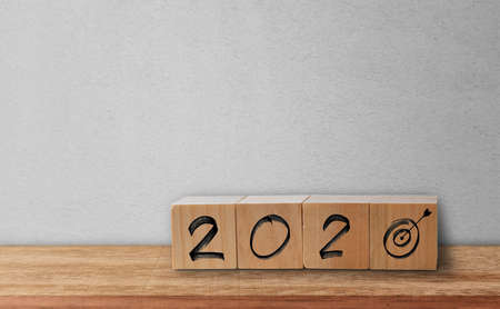 Writing word 2020 and Goal icon on wood cubes. Business success goal concept Standard-Bild - 142283886