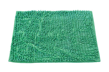 Blank green welcome mat isolated on white background. Banco de Imagens