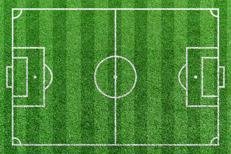 Top view stripe grass soccer field. Green lawn with white lines pattern background. Banque d'images