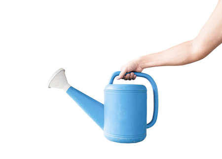 Hand holding a blue watering can, Isolated on white background   . Concept  gardening.