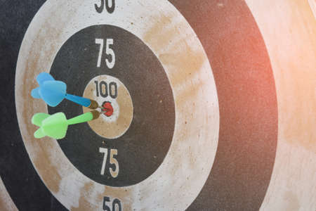 Symbol of goal. Darts arrows the target center (selective focus). Business concept