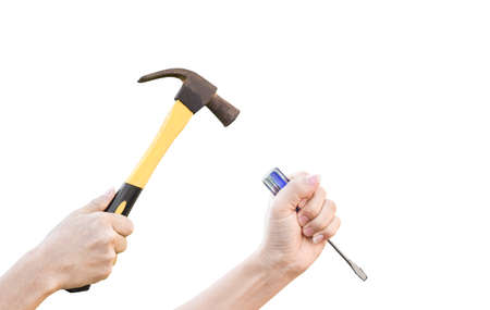 Male hands working with old rusty hammer and flat screwdriver isolated on white background with clipping path. Stock Photo