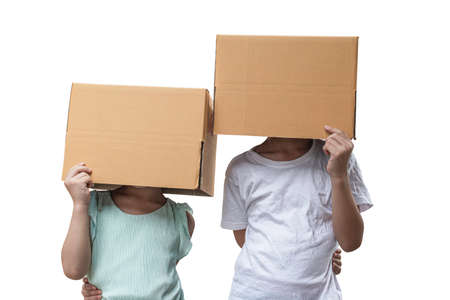 Two little girl wearing cardboard box on his head, Isolated on white background.