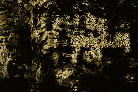 Dark grunge background of golden texture