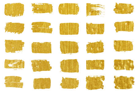 Collection of golden paint strokes. Grunge abstract hand painted element gold strokes with a brush. Standard-Bild