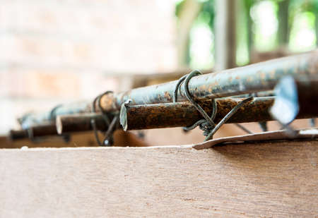 A bar of Steel is tied with a smaller wire Stock Photo - 16263015