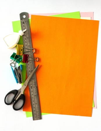 Binder,stapler,glue,scissor,ruler on color papers