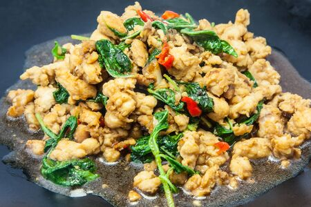 Stir chicken with basil,garlic and chili