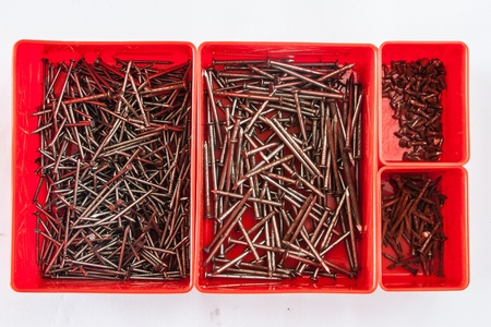 Many size of nail in a red box Stock Photo - 16642336
