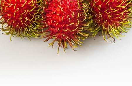 Three rambutans on a white background photo