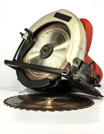 The circular saw is a machine using a toothed metal cutting disc or blade photo