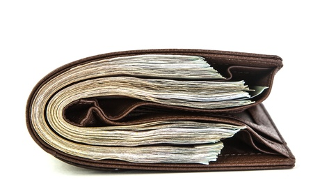 Many money in pocket on white background photo
