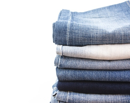 whie: Stack of jean on whie background Stock Photo