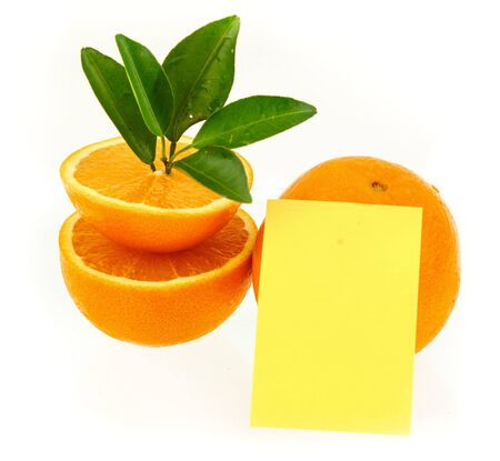 Fresh and juicy orange fruit with yellow notepaper on white background Stock Photo