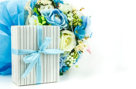 A giftbox in front of a bouquet on white background