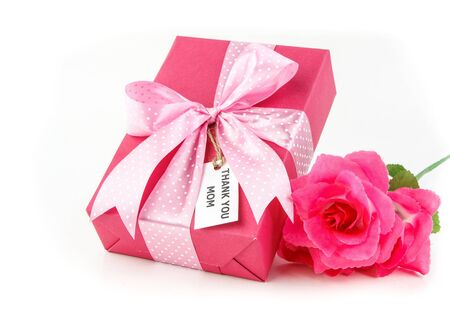 Pink gift with beautiful bow and tag for mother on white background photo
