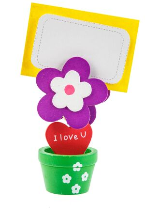 a flower shape wooden clip with blank notepaper on white background photo