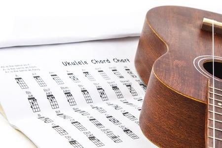 chord: Ukulele and ukulele chord chart document on white background Stock Photo