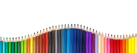 Colorful pencil arrange as curve on white background
