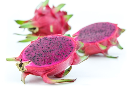 Red dragon fruit,ripe and juicy  on white bacnground