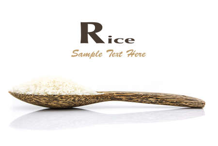 Rice grain on wooden spoon on white background