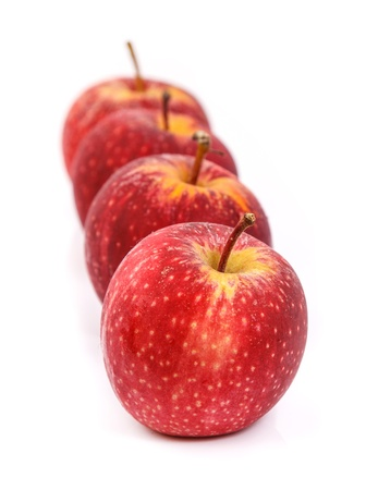 arrange: Red apple arrange in row on white background