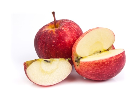 Slice of red apple on white background photo