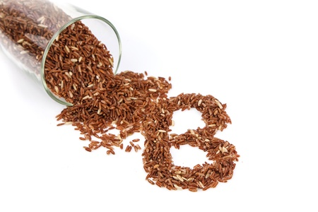 Coarse rice grain arrange as B on white background