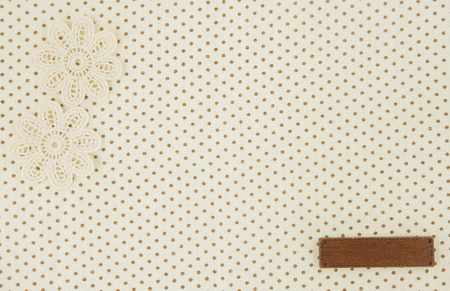 Brown dot cloth as background wih tag Stock Photo