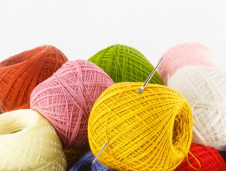 Close up of colorful yarn on white background for craft work