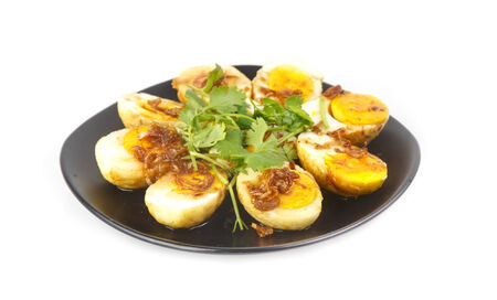 Dish of Thai traditional food - Egg with tamarind sauce isolated on white