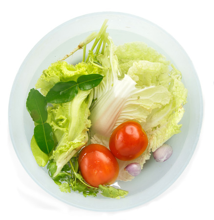 Top view of fresh vegetables soak in water for healty food