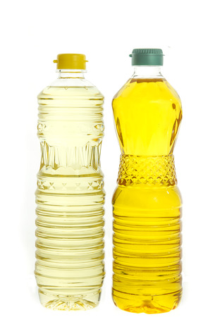 Soybean oil and palm oil in plastic bottle isolated on white background photo