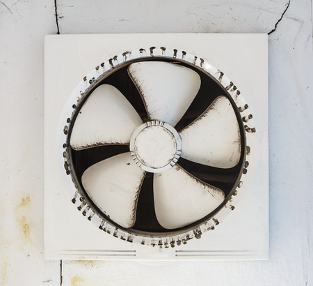 exhaust fan: Dirty  platic  exhaust fan - vent air Stock Photo