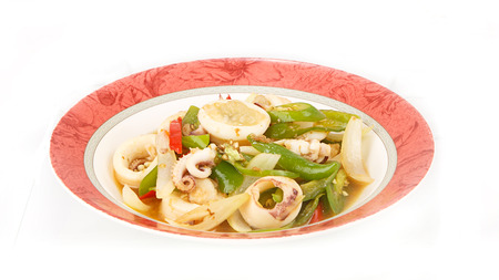 Stir fried chili pepper with squid isolted on white background