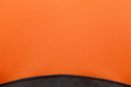 Black and orange leather texture background - rough surface photo