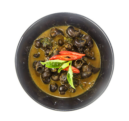 Bowl of thai food- curry with pond snail on white background Stock Photo