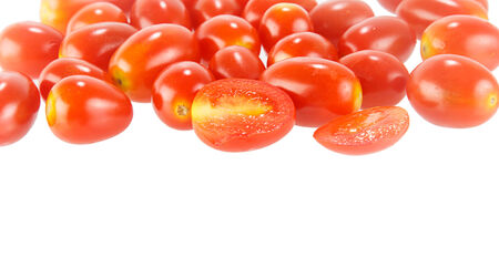 Heap of fresh red  tomatoes vegetable on white background