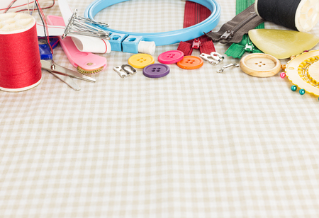 craft background: Embroidery tools on fabric as craft background