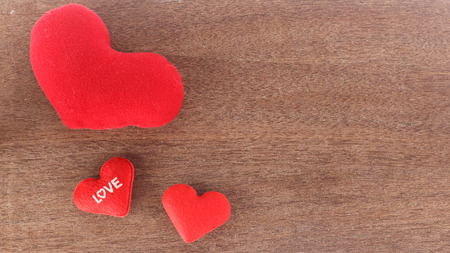 valentines day background - top view of red hearts  on wooden  background
